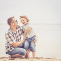 Father And Son Playing On The Beach At The Day Time. Royalty Free Stock Photo - 52447695