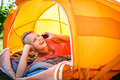 Pretty, Young Woman Camping Outdoors, Lying In The Tent Royalty Free Stock Image - 52471006