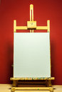Painting Easel With White Canvas For Text In Dramatic Light Stock Photos - 52478323