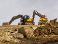 Excavator On A Road Construction Site Royalty Free Stock Photo - 52487615