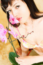 Asian Girl With Orchid Royalty Free Stock Photography - 5257377