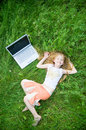 Funny Little Girl With Laptop Outside Royalty Free Stock Photos - 5258998