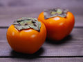 Two Persimmons Stock Photo - 52510050