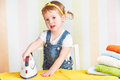 Cute  Baby Girl Housewife Iron Clothes Iron, Is Engaged In Domes Royalty Free Stock Image - 52555126