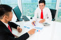 Asian Banker Counseling Financial Investment Stock Images - 52565514