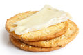 Three Golden Cheese Crackers On White. Stock Photos - 52584123