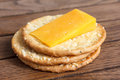 Three Golden Cheese Crackers On Wood. Royalty Free Stock Photos - 52584258