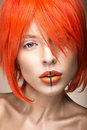 Beautiful Girl In An Orange Wig Cosplay Style With Bright Creative Lips. Art Beauty Image. Royalty Free Stock Images - 52586969