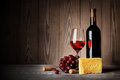 Bottle And Glass Of Red Wine With Cheese Grapes Royalty Free Stock Photo - 52605995