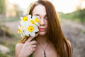 Red-haired Young Lady With Bouquet Of Daffodils Stock Image - 52629541