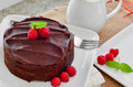 Fresh Home Made Sticky Chocolate Fudge Cake With Raspberries Royalty Free Stock Images - 52631049