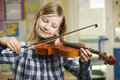 Girl Learning To Play Violin In School Music Lesson Royalty Free Stock Images - 52633339