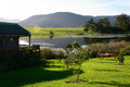 Wooden House On Dam With Canoes In The Garden Route, South Africa Royalty Free Stock Photos - 52637638