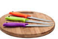 Kitchen Knives With Colorful Plastic Handles On A Wooden Board Royalty Free Stock Images - 52640389