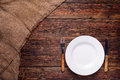 Empty White Plate With Fork And Knife On Rustic Wooden Background Royalty Free Stock Photography - 52649657
