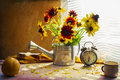 Still Life With Bouquet Yellow Rudbeckia Watering Can Clock Stock Photography - 52652422