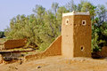 Middle-Eastern Watchtower And Wall Ruins Made Of Mud Stock Photography - 52675052