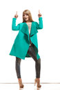 Woman In Green Coat Showing Copy Space Stock Photo - 52676190