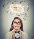 Woman Anticipating A Baby Looking Up Holding Alarm Clock Stock Photography - 52676652