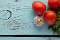 Tomato, Garlic, Parsley Over Blue Wooden Background Left Royalty Free Stock Photography - 52687837