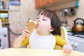 Nice Little Boy Age Of 2 Years Eats Ice-cream Cone On The Kitche Royalty Free Stock Images - 52695759