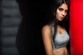 Woman Boxer Near Red Punching Bag Stock Photography - 52696222