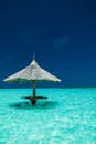Bamboo Beach Umbrella With Bar Seats In The Water Of An Island Stock Photo - 52696620