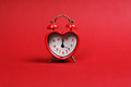 Time For Love. Red Heart Shaped Alarm Clock On Red Background Stock Photos - 52700203