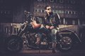 Biker And His Bobber Style Motorcycle Royalty Free Stock Images - 52733479