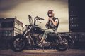 Biker And His Bobber Style Motorcycle Royalty Free Stock Photos - 52733488