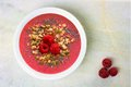 Smoothie Bowl With Raspberries, Superfoods On White Granite Royalty Free Stock Images - 52751859