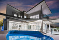 Mansion With Pool And Beautiful Sky At Dusk Royalty Free Stock Photo - 52754155