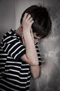 Scared And Abused Young Boy Stock Photography - 52828622