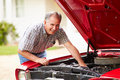Retired Senior Man Working On Restored Car Royalty Free Stock Images - 52854789