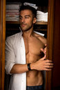 Sexy Young Man Standing Almost Shirtless Peering Stock Photos - 52857113
