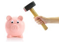 Hand With Hammer And Piggy Bank Royalty Free Stock Photos - 52875308