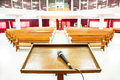 Closeup Microphone In Empty Church With Empty Pews Stock Photography - 52898402