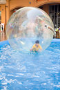 Young Boy In Rubber Ball Floating On Water Royalty Free Stock Images - 5295629