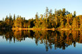 Spider Lake And Forest At Sunset Stock Photography - 5299662