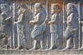 Figures Of Soldiers In Ancient Costumes On The Destroyed Stone Bas-relief Stock Photo - 52900170