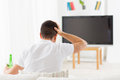 Man Watching Tv And Drinking Beer At Home Royalty Free Stock Images - 52947449