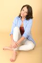 Thoughtful Happy Young Woman Sitting On Floor Royalty Free Stock Photography - 52982537