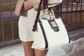 Fashion Young Woman With Handbag And White Skirt Royalty Free Stock Photo - 52998265