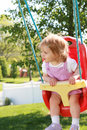Little Girl Swinging Stock Images - 5300604