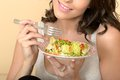 Healthy Woman Eating A Mixed Leaf Salad Royalty Free Stock Photos - 53001468