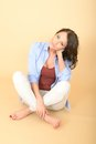 Thoughtful Attractive Beautiful Young Woman Sitting On The Floor Stock Images - 53007494