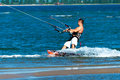 Kitesurfer Rides On The Surfboard And Enjoys The Sea Royalty Free Stock Photography - 53011527