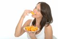 Healthy Happy Natural Young Woman Eating A Plate Of Fresh Ripe Orange Segments Royalty Free Stock Images - 53025379
