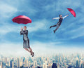 People Flying In The Sky With Umbrellas Stock Images - 53026644