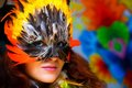 Young Woman With A Colorful Feather Carnival Face Mask On Bright Colorful Background, Eye Contact, Make Up Artist. Royalty Free Stock Photography - 53031447